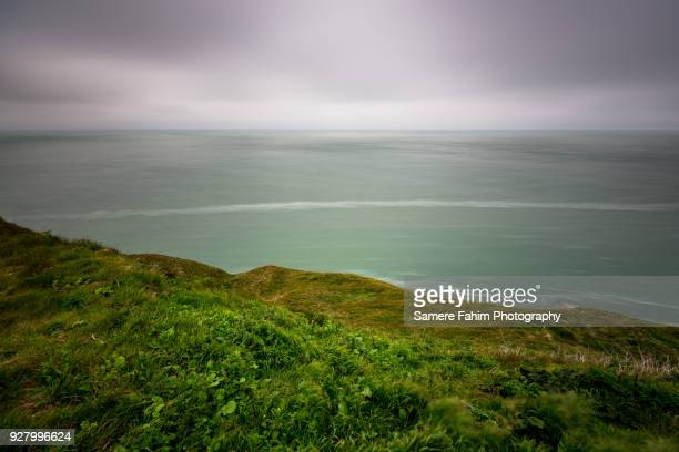 scenic view of coastal landscape against a cloudy sky - nord frankrijk stockfoto's en -beelden