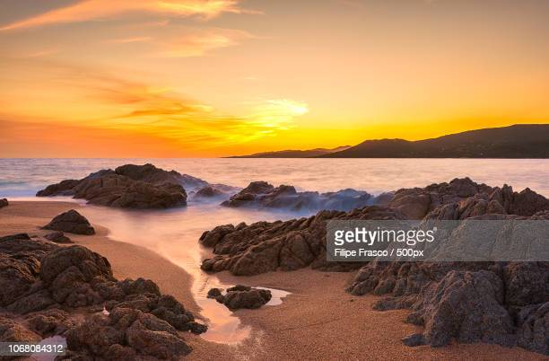 scenic view of coastline at dusk - ajaccio stock photos and pictures