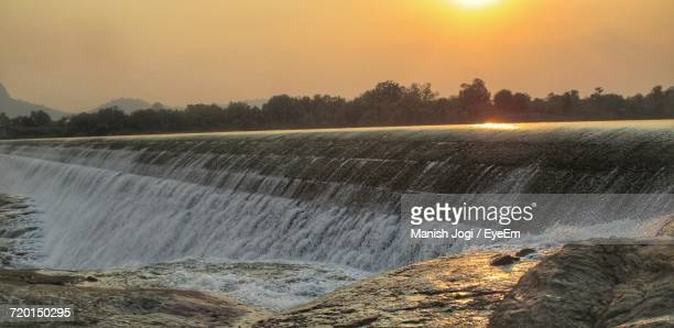 Scenic View Of Dam Against Sky During Sunset