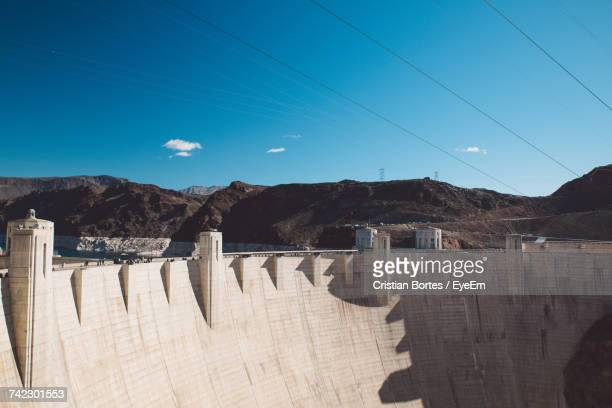 scenic view of dam against sky - bortes stockfoto's en -beelden