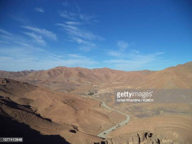 scenic view of desert against blue sky - ismail khairdine stock photos and pictures
