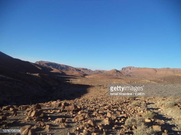 scenic view of desert against clear blue sky - ismail khairdine stock photos and pictures