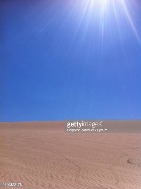 scenic view of desert against clear blue sky - marquer stock pictures, royalty-free photos & images