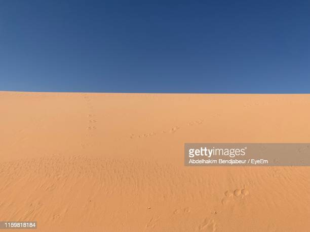 scenic view of desert against clear blue sky - 砂漠 ストックフォトと画像