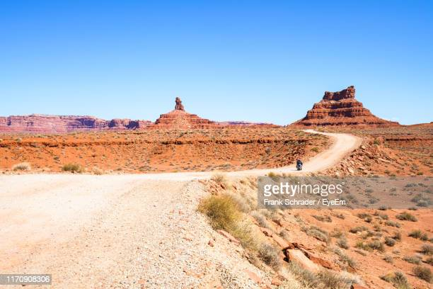 scenic view of desert against clear blue sky - frank schrader stock pictures, royalty-free photos & images