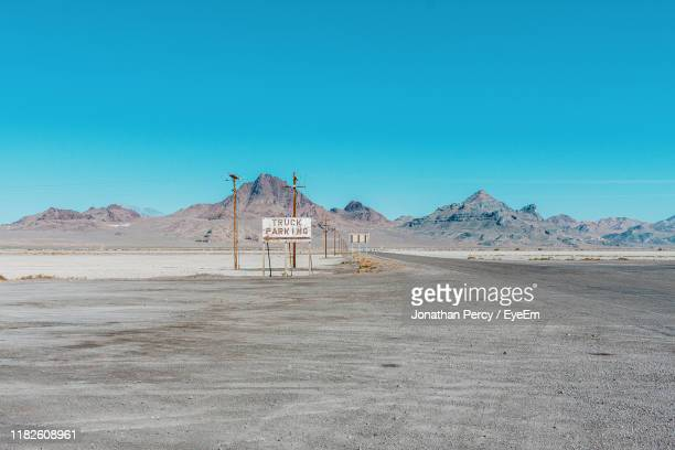 scenic view of desert against clear blue sky - bonneville salt flats stock pictures, royalty-free photos & images