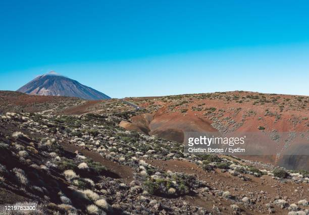 scenic view of desert against clear blue sky - bortes stock pictures, royalty-free photos & images