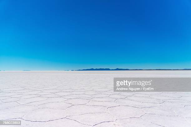 scenic view of desert against clear blue sky - horizon over land stock pictures, royalty-free photos & images