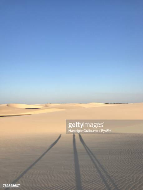 scenic view of desert against clear blue sky - barreirinhas stock pictures, royalty-free photos & images