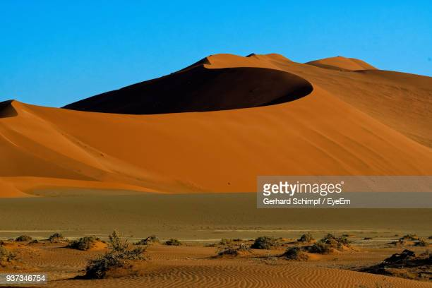 scenic view of desert against clear blue sky - gerhard schimpf stock photos and pictures