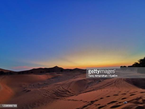 scenic view of desert against clear sky during sunset - twilight stock pictures, royalty-free photos & images