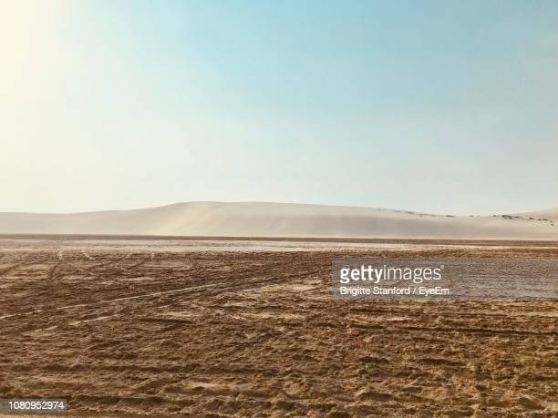 scenic view of desert against clear sky - qatar stock pictures, royalty-free photos & images