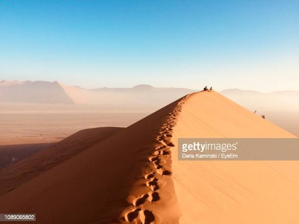 scenic view of desert against clear sky - namibia stock pictures, royalty-free photos & images