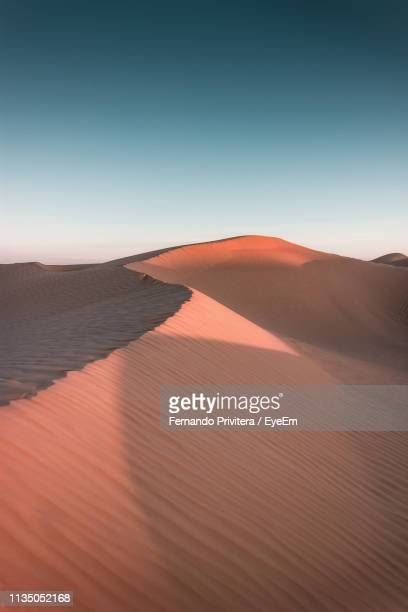 scenic view of desert against clear sky - tunisia stock pictures, royalty-free photos & images