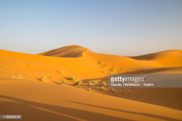 scenic view of desert against clear sky - claudia romanazzo foto e immagini stock