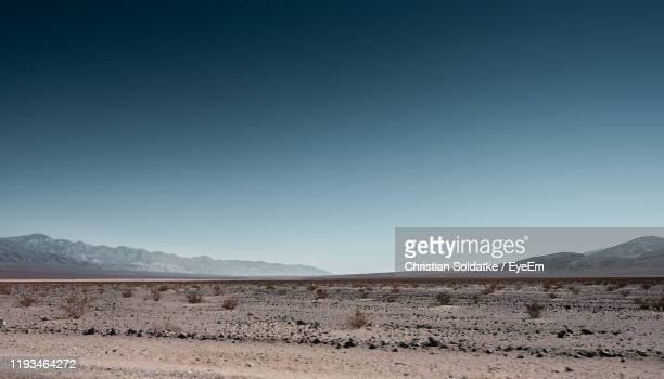 scenic view of desert against clear sky - christian soldatke stock pictures, royalty-free photos & images