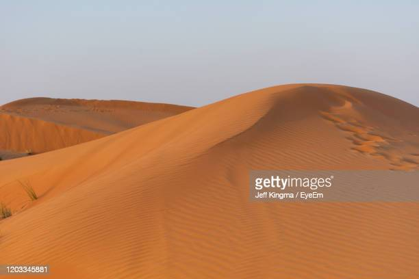 scenic view of desert against clear sky - ras al khaimah stock pictures, royalty-free photos & images