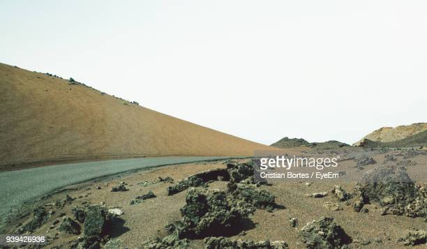 scenic view of desert against clear sky - bortes stock photos and pictures