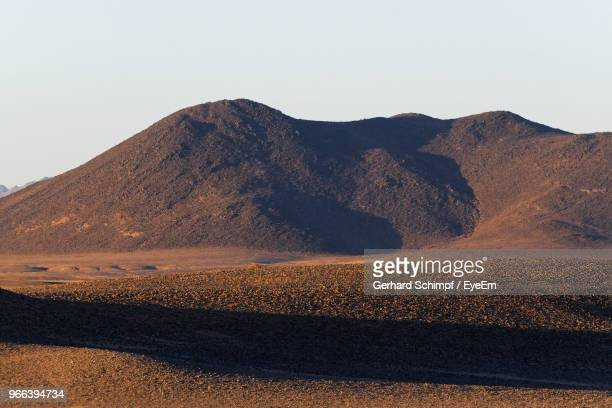 scenic view of desert against clear sky - gerhard schimpf stock photos and pictures