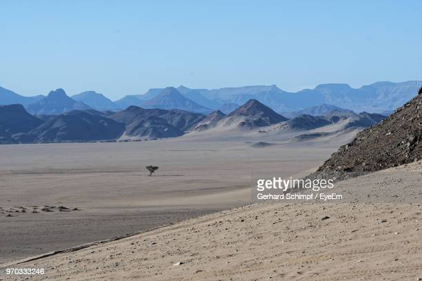 scenic view of desert against clear sky - gerhard schimpf stock pictures, royalty-free photos & images