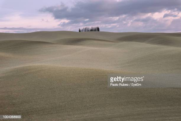 scenic view of desert against cloudy sky - san quirico d'orcia stock pictures, royalty-free photos & images