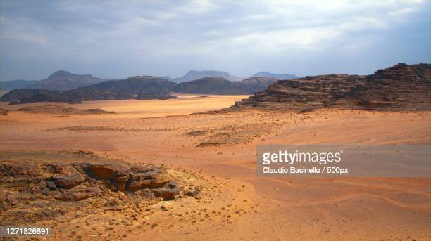 scenic view of desert against sky, ad dsah, jordan - images stock pictures, royalty-free photos & images