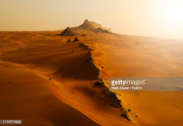 scenic view of desert against sky during sunset - emirate of sharjah stock pictures, royalty-free photos & images