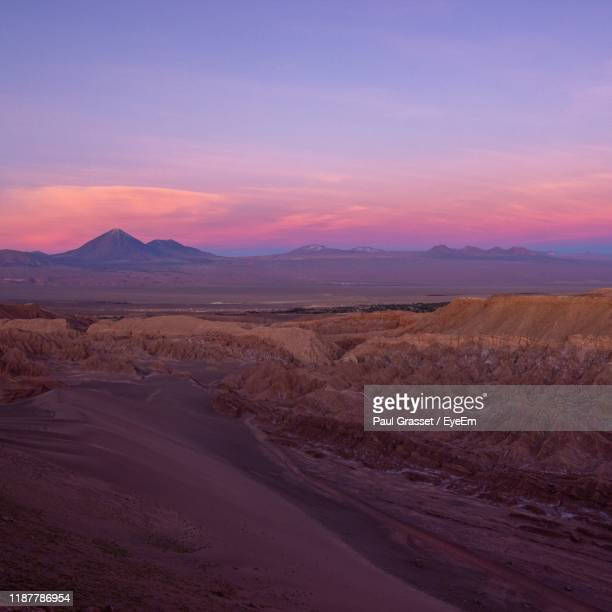 scenic view of desert against sky during sunset - golden hour stock pictures, royalty-free photos & images