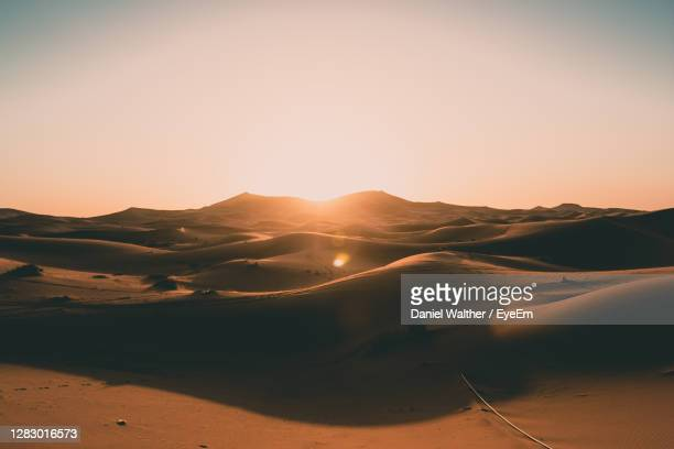 scenic view of desert against sky during sunset - desert stock pictures, royalty-free photos & images
