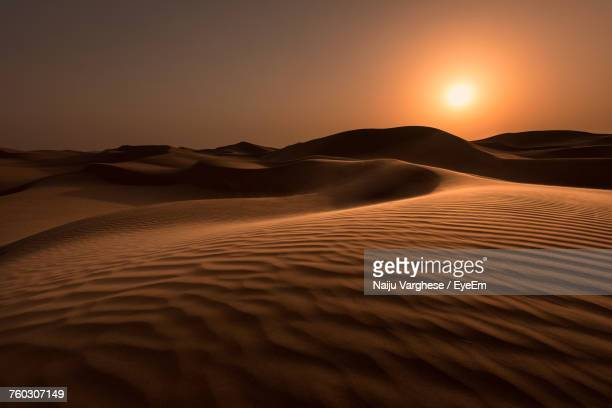scenic view of desert against sky during sunset - sand dune stock pictures, royalty-free photos & images