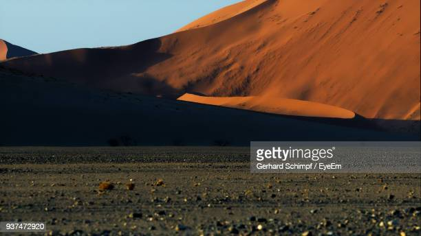 scenic view of desert against sky during sunset - gerhard schimpf stock photos and pictures