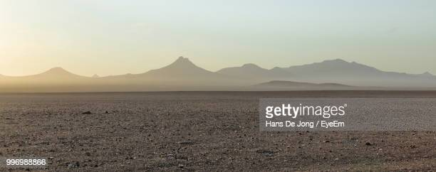 scenic view of desert against sky during sunset - salt flat stock pictures, royalty-free photos & images