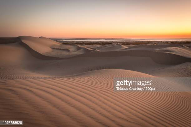 scenic view of desert against sky during sunset,dampier peninsula,western australia,australia - images stock pictures, royalty-free photos & images