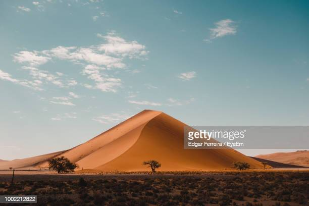 scenic view of desert against sky - namibia stock pictures, royalty-free photos & images