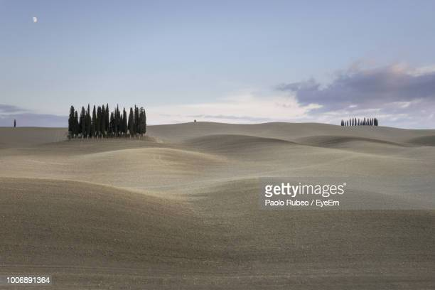 scenic view of desert against sky - san quirico d'orcia stock pictures, royalty-free photos & images