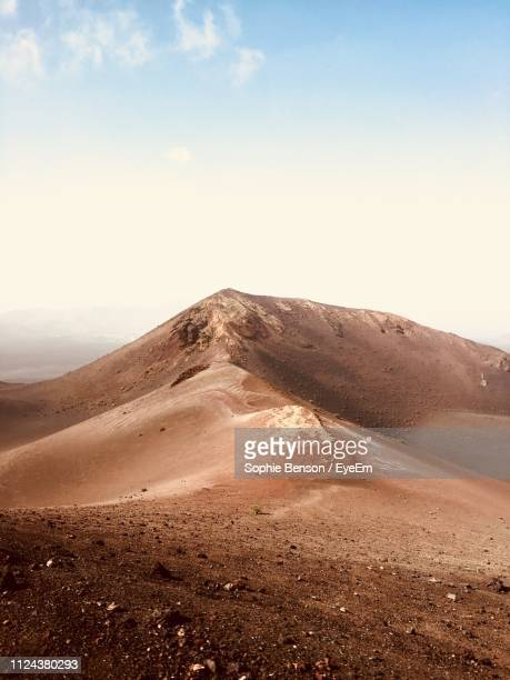scenic view of desert against sky - lanzarote stock pictures, royalty-free photos & images