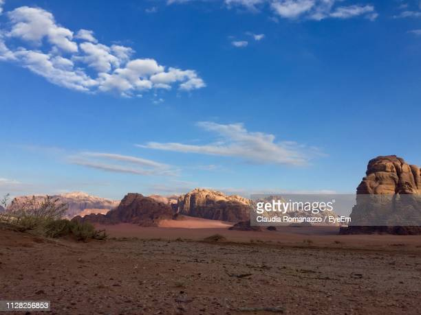 scenic view of desert against sky - claudia romanazzo foto e immagini stock