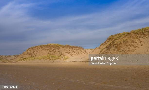 scenic view of desert against sky - sarah sands stock pictures, royalty-free photos & images
