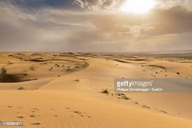 scenic view of desert against sky - iraq stock pictures, royalty-free photos & images