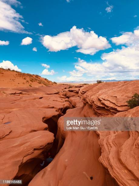 scenic view of desert against sky - slot canyon stock pictures, royalty-free photos & images