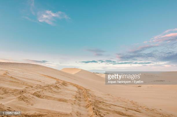 scenic view of desert against sky - atmospheric mood stock pictures, royalty-free photos & images
