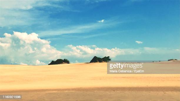 scenic view of desert against sky - kitty hawk stock pictures, royalty-free photos & images