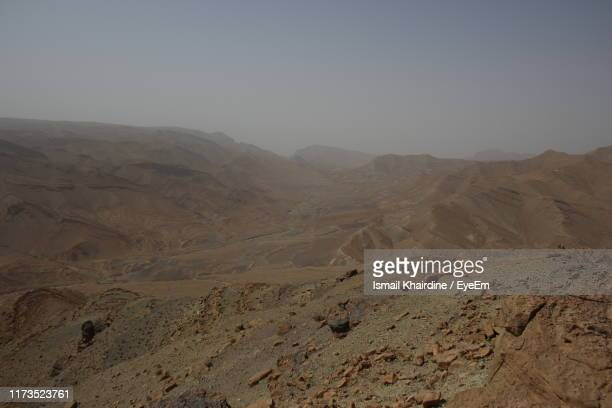 scenic view of desert against sky - ismail khairdine stock photos and pictures