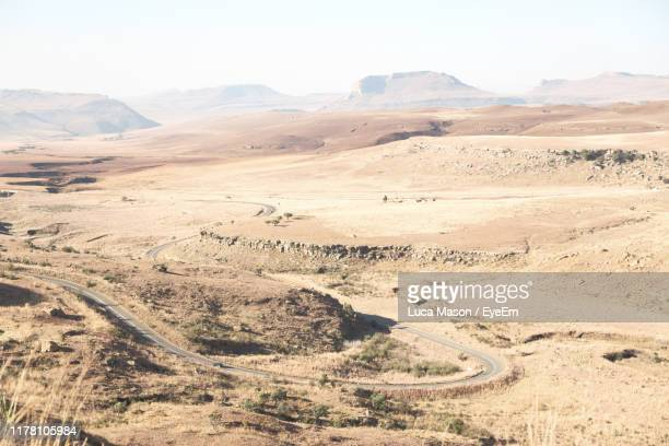 scenic view of desert against sky - semi arid stock pictures, royalty-free photos & images