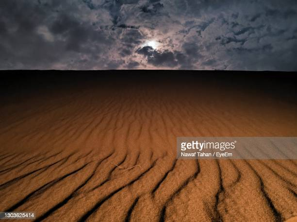 scenic view of desert against sky - night safari stock pictures, royalty-free photos & images