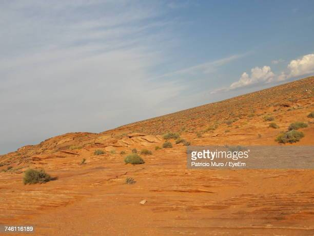 scenic view of desert against sky - muro stock photos and pictures