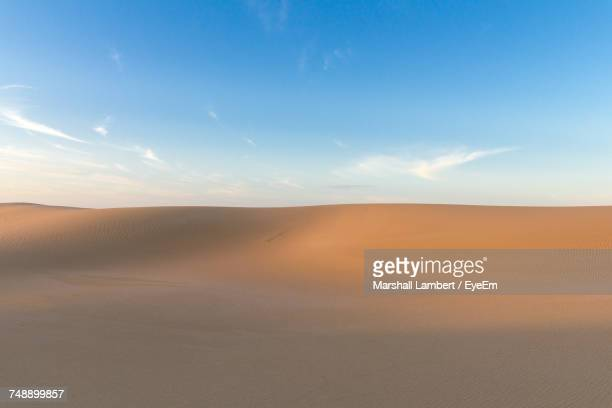 scenic view of desert against sky - horizon over land stock photos and pictures