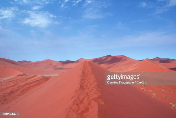 scenic view of desert against sky - carolina fragapane stock pictures, royalty-free photos & images