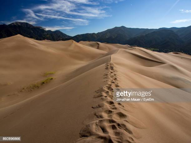 scenic view of desert against sky - great sand dunes national park stock pictures, royalty-free photos & images