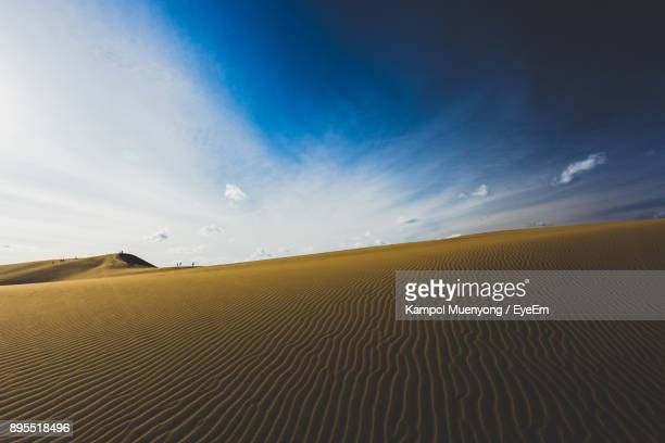 scenic view of desert against sky - tottori prefecture stock photos and pictures